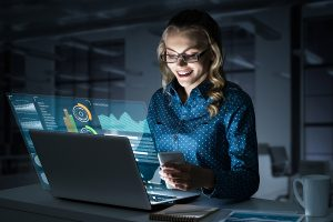 Woman looking at computer screen with data points